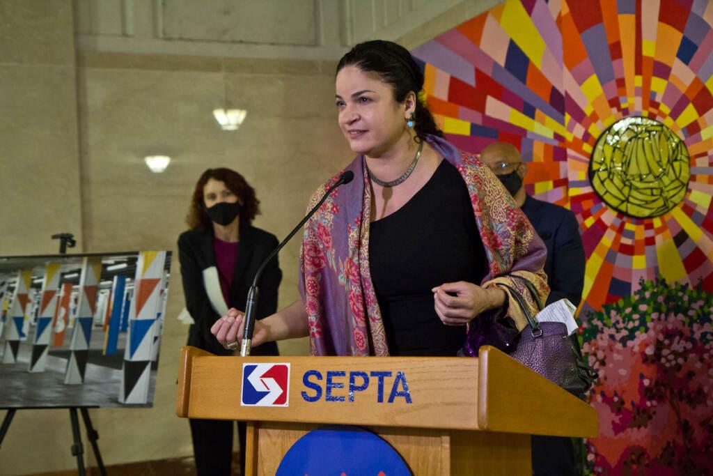 Mosaic Artist Ellen Tiberino speaks at the dedication of the Opposing Forces mural at Suburban Station in Philadelphia on October 7, 2021