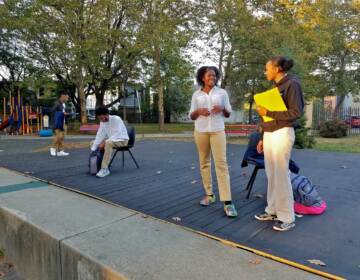 Cast members (from right) Azzari Myers, Eva Vanterpool, Carmi Jackson, and Jamall Phillips rehearse ''Town Hall: Resolution 50'' in Camden's Northgate Park. The play about environmental racism in Camden will be performed this Saturday, in the park