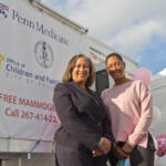 Dr. Linda Nunes (left) with Dr. DaCarla Albright (right) at Penn Medicine's mobile mammography unit in a North Philadelphia parking lot on Oct. 22, 2021