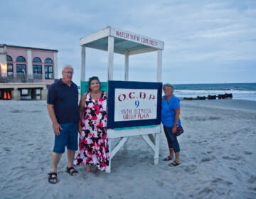 Mark Hornick (left), Suzanne Hornick (center) and Susan Cox (right) on the Ocean City, N.J. beach in August 2021. (Kimberly Paynter/WHYY)