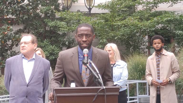Councilmember Isaiah Thomas calls for people to register to vote at a rally on Monday, October 11, 2021. (Tom MacDonald WHYY)