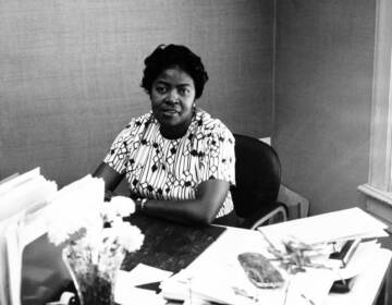 Dorothy Bolden working at her desk at the NDWUA offices in Atlanta