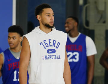 Ben Simmons stands during a Sixers practice