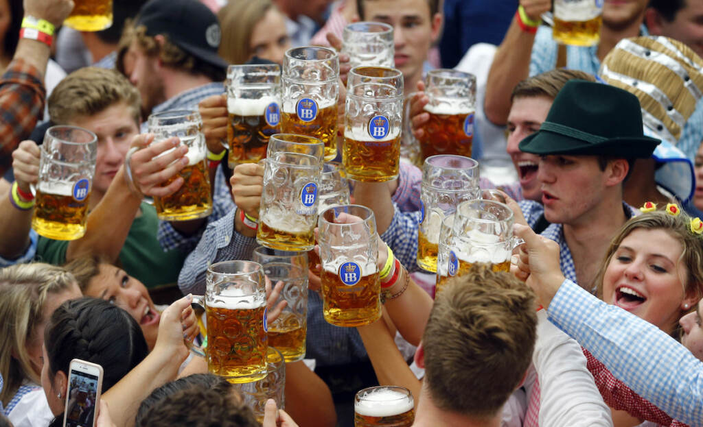 FILE - In this Sept. 19, 2015 file photo, people celebrate the opening of the 182nd Oktoberfest beer festival