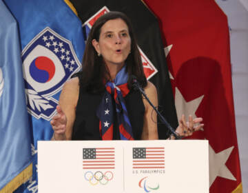 In this Aug. 1, 2017, file photo, U.S. Olympic Committee chief marketing officer Lisa Baird speaks about the Team USA WinterFest for the upcoming 2018 Pyeongchang Winter Olympic Games, at Yongsan Garrison, a U.S. military base in Seoul, South Korea