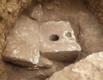 In this photo provided by Israel Antiquities Authority shows a rare ancient toilet in Jerusalem dating back more than 2,700 years Jerusalem, Tuesday, Oct. 5, 2021. The Israeli Antiquities Authority said on Tuesday that the smooth, carved limestone toilet was found in a rectangular cabin that was part of a sprawling mansion overlooking what is now the Old City. ( Yoli Schwartz/ Israel Antiquities Authority via AP)