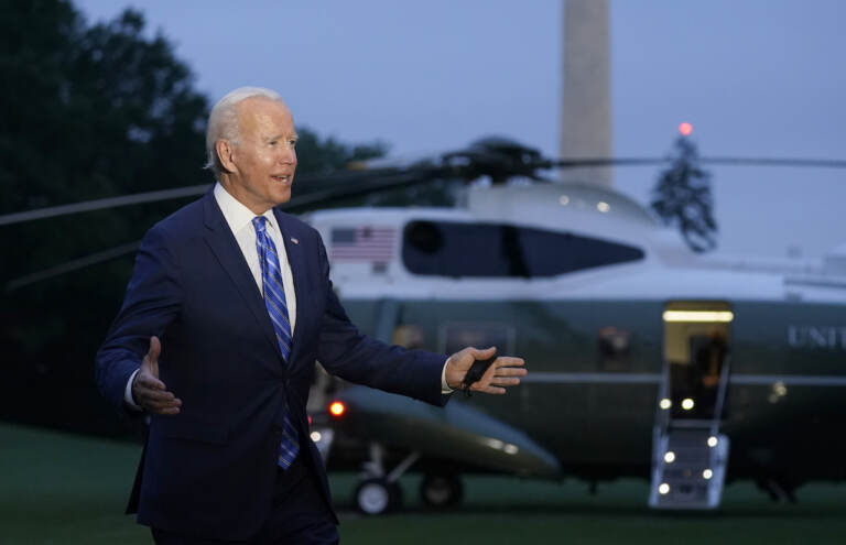 President Joe Biden talks with reporters after returning to the White House in Washington, Tuesday, Oct. 5, 2021, after a trip to Michigan to promote his infrastructure plan