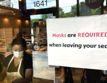 FILE - In this June 17, 2021, file photo, a sign requiring masks is displayed at a restaurant in Rolling Meadows, Ill. (AP Photo/Nam Y. Huh, File)