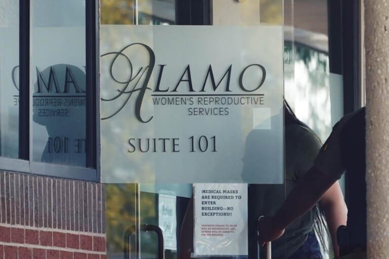 A woman enters Alamo Women's Reproductive Services, Thursday, Oct. 7, 2021, in San Antonio