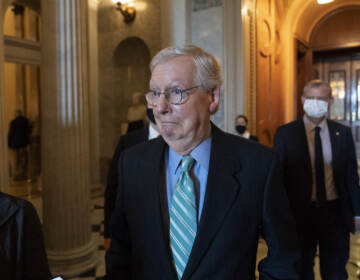 Senate Minority Leader Mitch McConnell of Ky., walks to a policy luncheon on Capitol Hill, Thursday, Oct. 7, 2021, in Washington