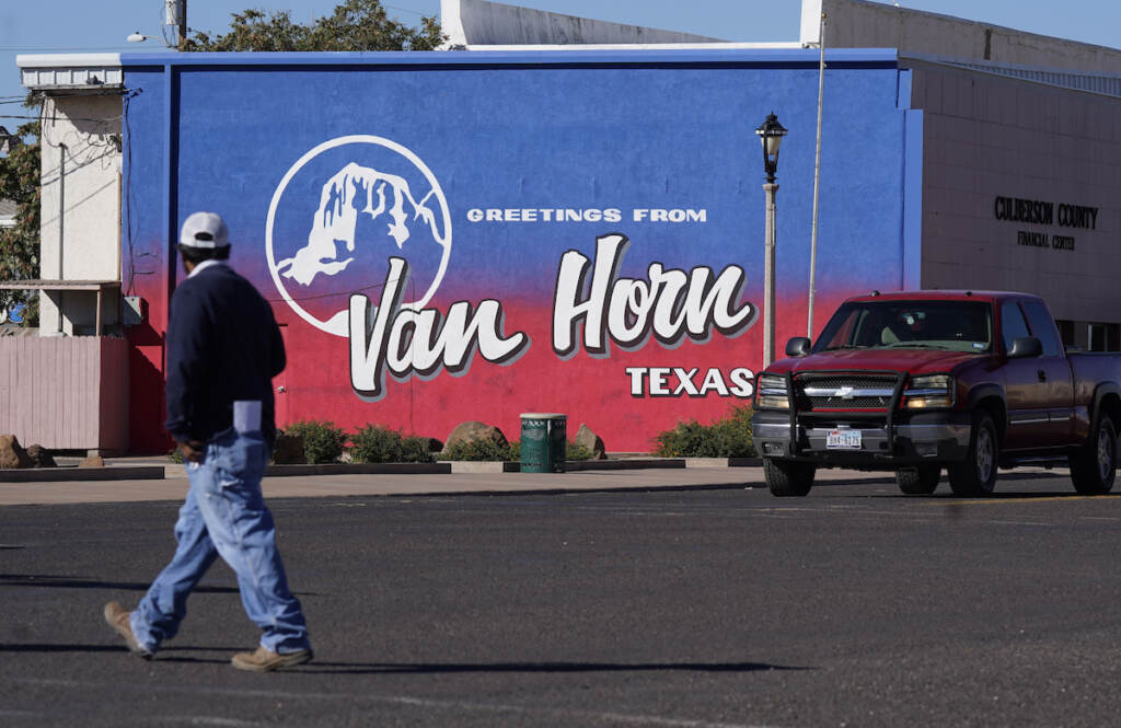A pedestrian crosses the street in Van Horn, Texas, Monday, Oct. 11, 2021.