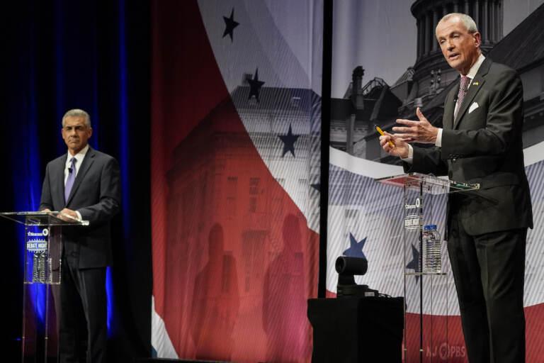 Incumbent Gov. Phil Murphy, D-N.J., right, speaks while Republican challenger Jack Ciattarelli listens during a gubernatorial debate at Rowan University's Pfleeger Concert Hall Tuesday, Oct. 12, 2021, in Glassboro, N.J.