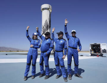 Blue Origin's New Shepard rocket latest space passengers from left, Audrey Powers, William Shatner, Chris Boshuizen, and Glen de Vries raise their hands during a media availability at the spaceport near Van Horn, Texas, Wednesday, Oct. 13, 2021