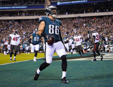 Philadelphia Eagles tight end Zach Ertz celebrates a touchdown during the first half of an NFL football game against the Tampa Bay Buccaneers on Thursday, Oct. 14, 2021, in Philadelphia