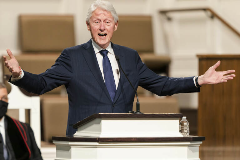 In this Jan. 27, 2021, file photo, former President Bill Clinton speaks during funeral services for Henry