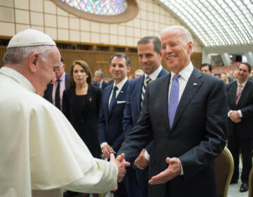In this April 29, 2016, file photo, Pope Francis shakes hands with Vice President Joe Biden as he takes part at a congress on the progress of regenerative medicine and its cultural impact, being held in the Pope Paul VI hall at the Vatican