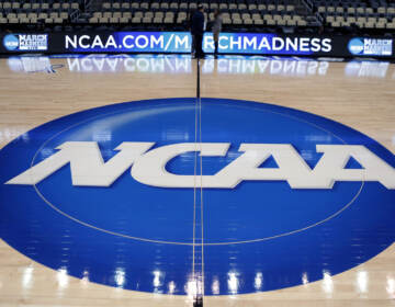 In this March 18, 2015, file photo, the NCAA logo is displayed at center court as work continues at The Consol Energy Center in Pittsburgh.