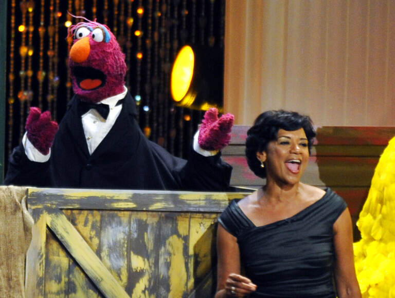 FILE - In this Aug. 30, 2009 file photo, actress Sonia Manzano, right, performs at the Daytime Emmy Awards in Los Angeles. Manzano, who has played the role of Maria on the groundbreaking kid show
