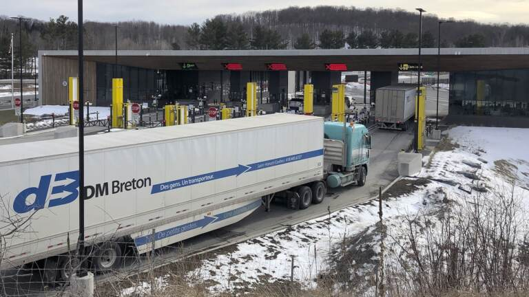 Truck traffic from Canada waits to cross the border
