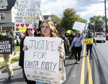 [in center]: Taylor Kowalski, from Ridley Park, marching alongside others. The Justice for Fanta Bility silent march in Sharon Hill, PA on 10/17/21. Fanta Bility was an eight year old girl who was shot and killed outside of a football game at Academy Park High School on August 27, 2021. The march had been organized and  led by the UDTJ and Delco Resists as a way to honor Fanta's life as well as call for police accountability.  [DANIELLA HEMINGHAUS]