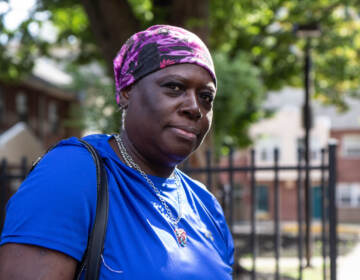 Karen Mouzone, a resident of the University City Townhomes, said that she and other affordable housing residents should not be removed from their homes, at a protest at 39th and Market Streets on October 14, 2021. (Kimberly Paynter/WHYY)