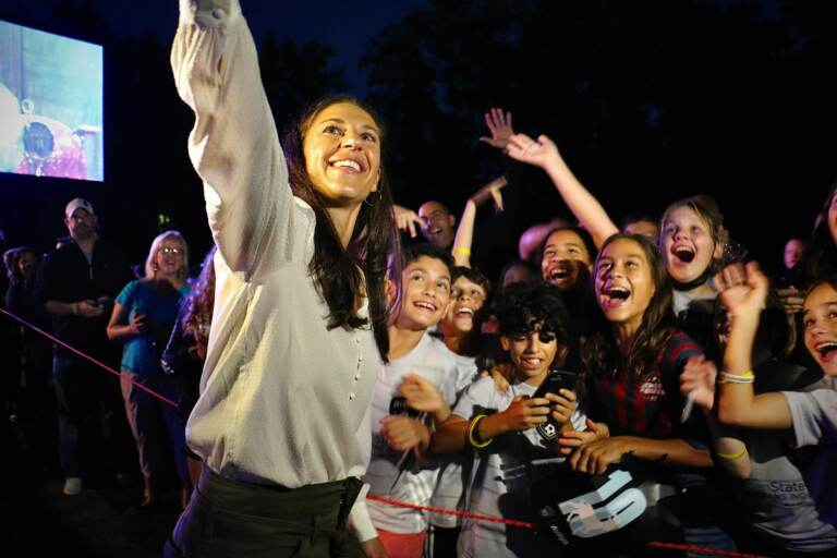 Carli Lloyd takes a selfie with some young soccer fans during a celebration of her storied soccer career in her hometown of Delran, N.J.