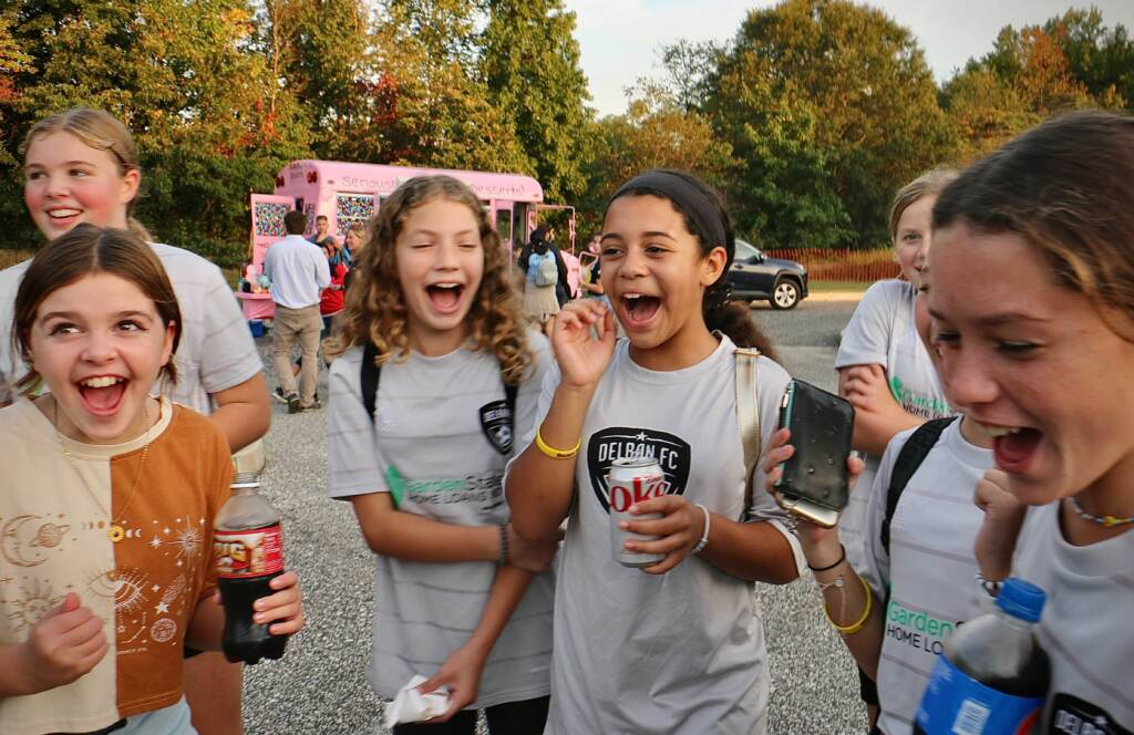 Members of the Delran Football Club get loud for Carli Lloyd. Hundreds attended a celebration of the hometown hero's soccer career at Delran Community Park
