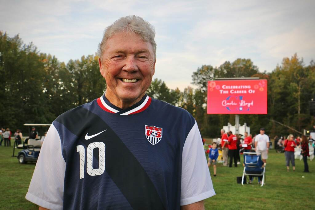 Carli Lloyd's uncle Wayne Wilson, 75, who traveled all over Europe to watch her play, arrives at her retirement celebration at Delran Community Park wearing her jersey