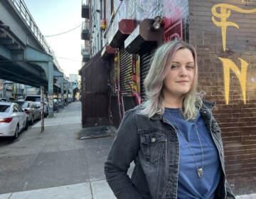 Amy Hartranft stands under the El in Philadelphia