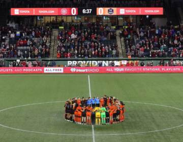 Portland Thorns and Houston Dash players, along with referees, gather at midfield, in demonstration of solidarity with two former NWSL players who came forward with allegations of sexual harassment and misconduct against a prominent coach, during the first half of an NWSL soccer match in Portland, Ore., Wednesday, Oct. 6, 2021