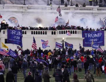 Protesters storm the Capitol on Jan. 6. (John Minchillo/AP)