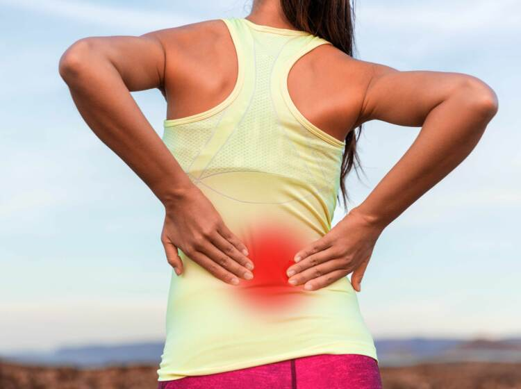 A woman with inflammed area in red halo on her lower back
