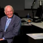 Bill Siemering sits at a desk