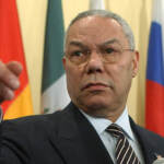 U.S. Secretary of State Colin Powell points to a reporter during a news conference