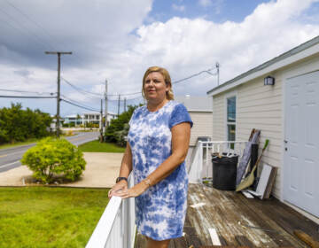 Amy Tripp stands on the deck of her new home