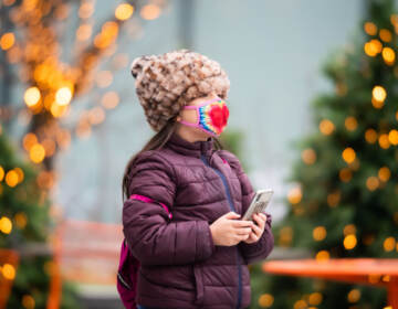 A child walks by a Christmas display