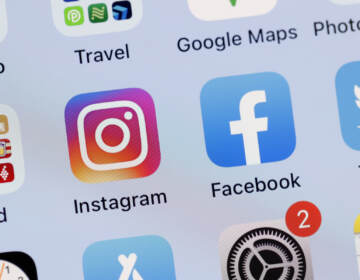In this photo illustration, the Facebook and Instagram apps are seen on the screen of an iPhone