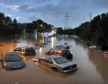 Cars submerged in floodwaters in a parking lot