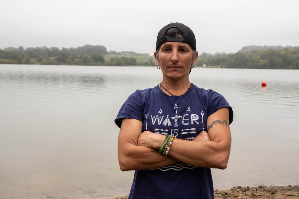 Christina Digiulio stands with her arms crossed in front of Marsh Creek