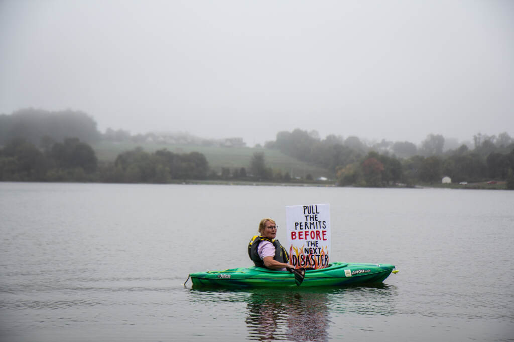 Libby Madarasz kayaks while protesting the Mariner East pipeline