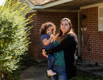 Erica Cuellar and her daughter Sara Alvarado pose for a portrait in front of their home