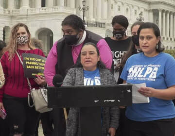 Marcela Ramirez speaks at a podium at a Build Back Better rally