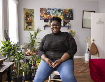 Iresha Picot sits on a stool in her home
