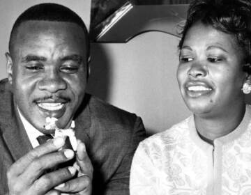 Sonny Liston holds a china dog from his collection as he sits with his wife Geraldine