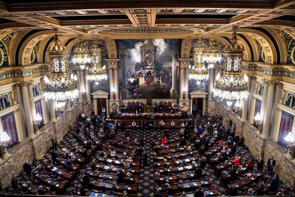 Lawmakers appear in the legislative chamber in Harrisburg