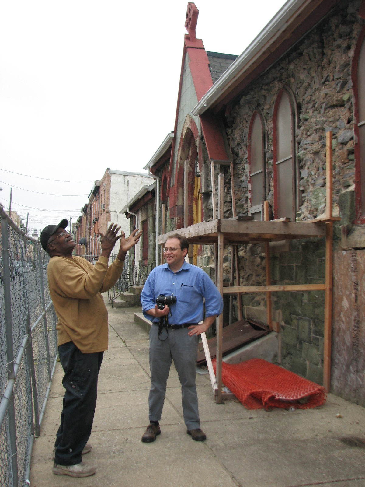 Lloyd Butler (left) and Aaron Wunsch discuss the restoration of the Titan Street side of the church.