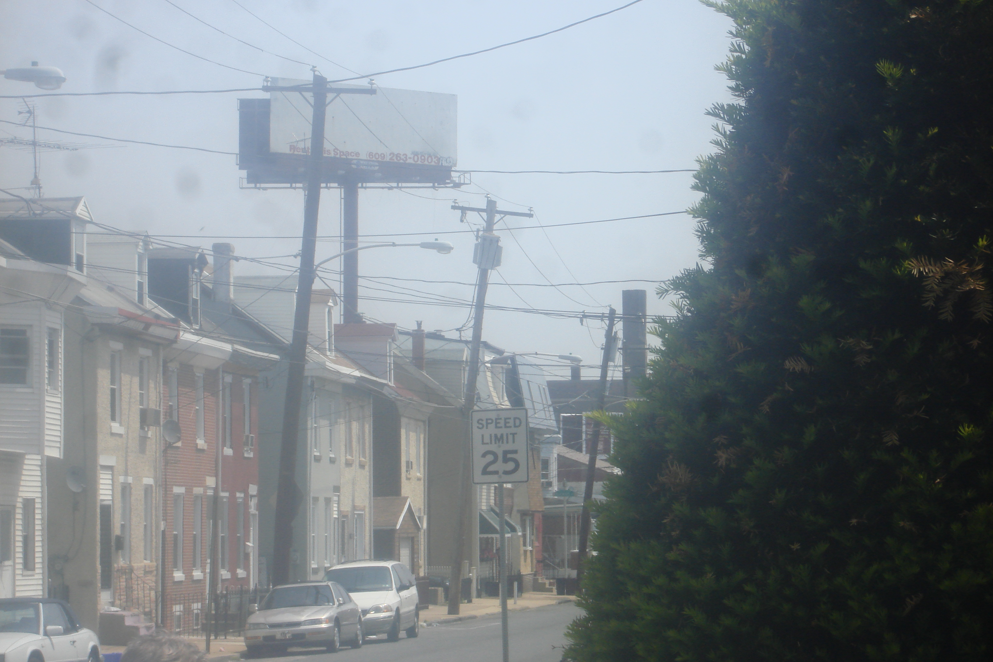 Billboards tower over Bridesburg homes