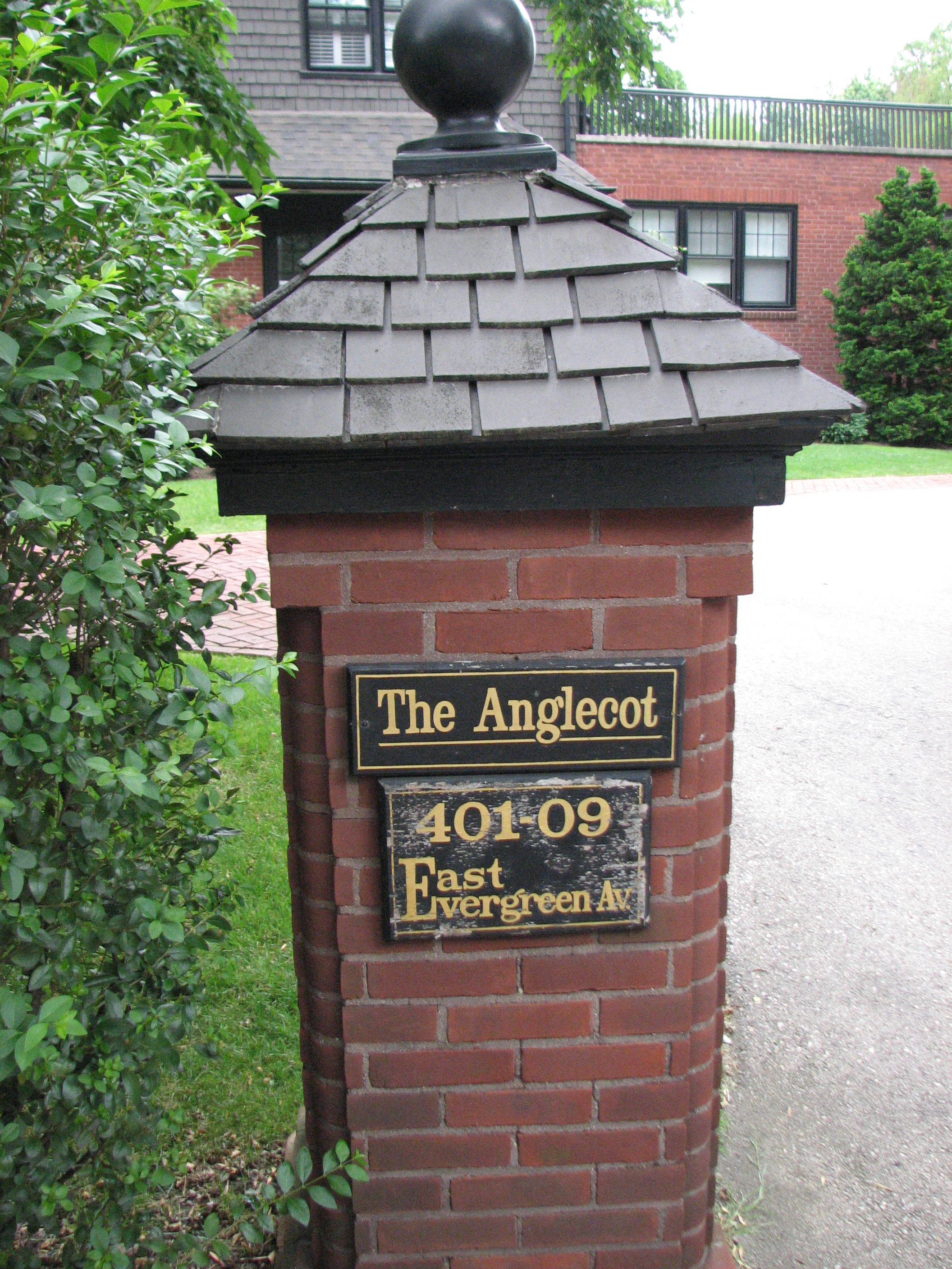 A brick and shingle column welcomes visitors to The Anglecot, 401 E. Evergreen Ave.