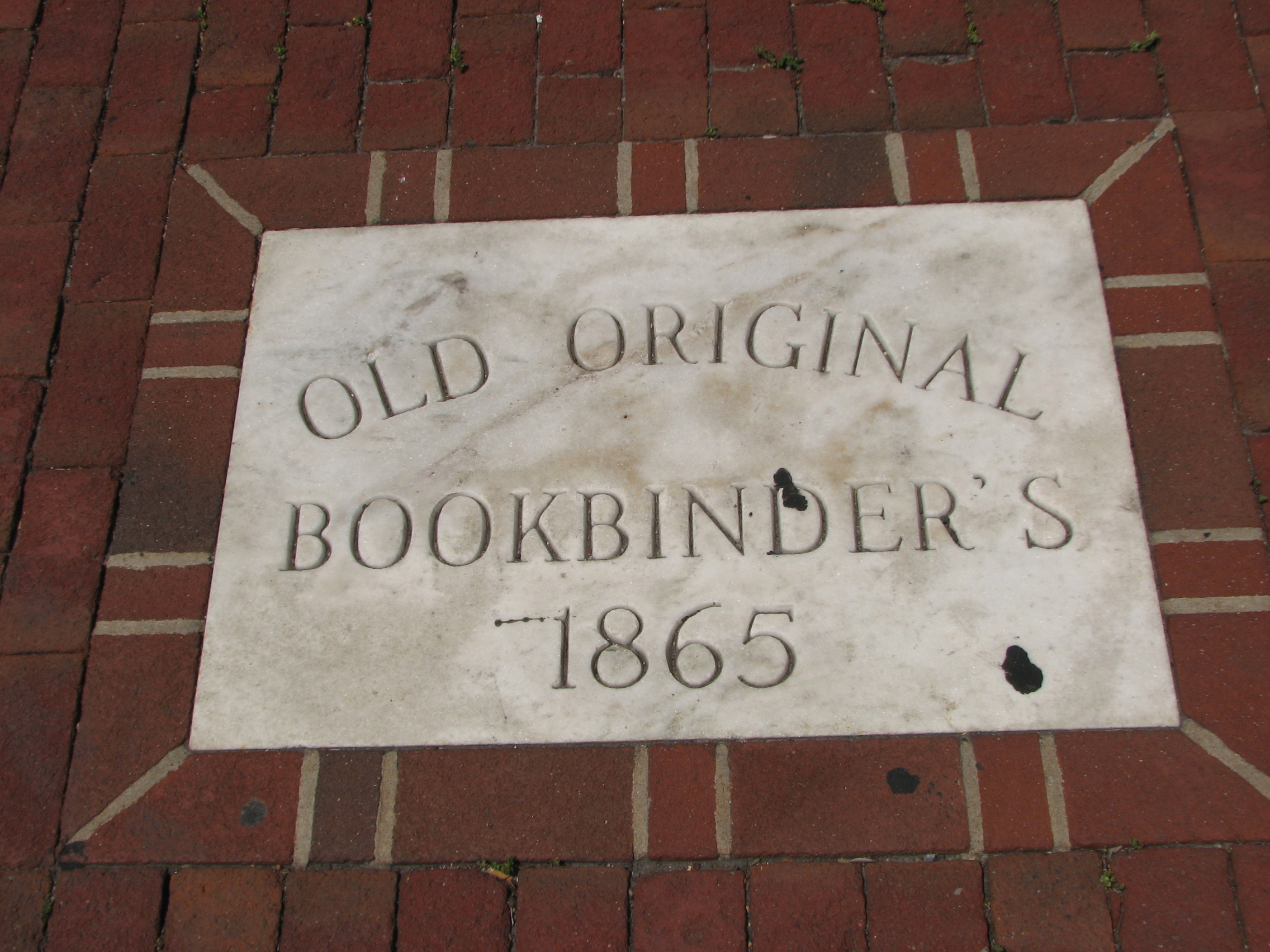 A plaque on the sidewalk in front of the restaurant claims origins that date to 1865.