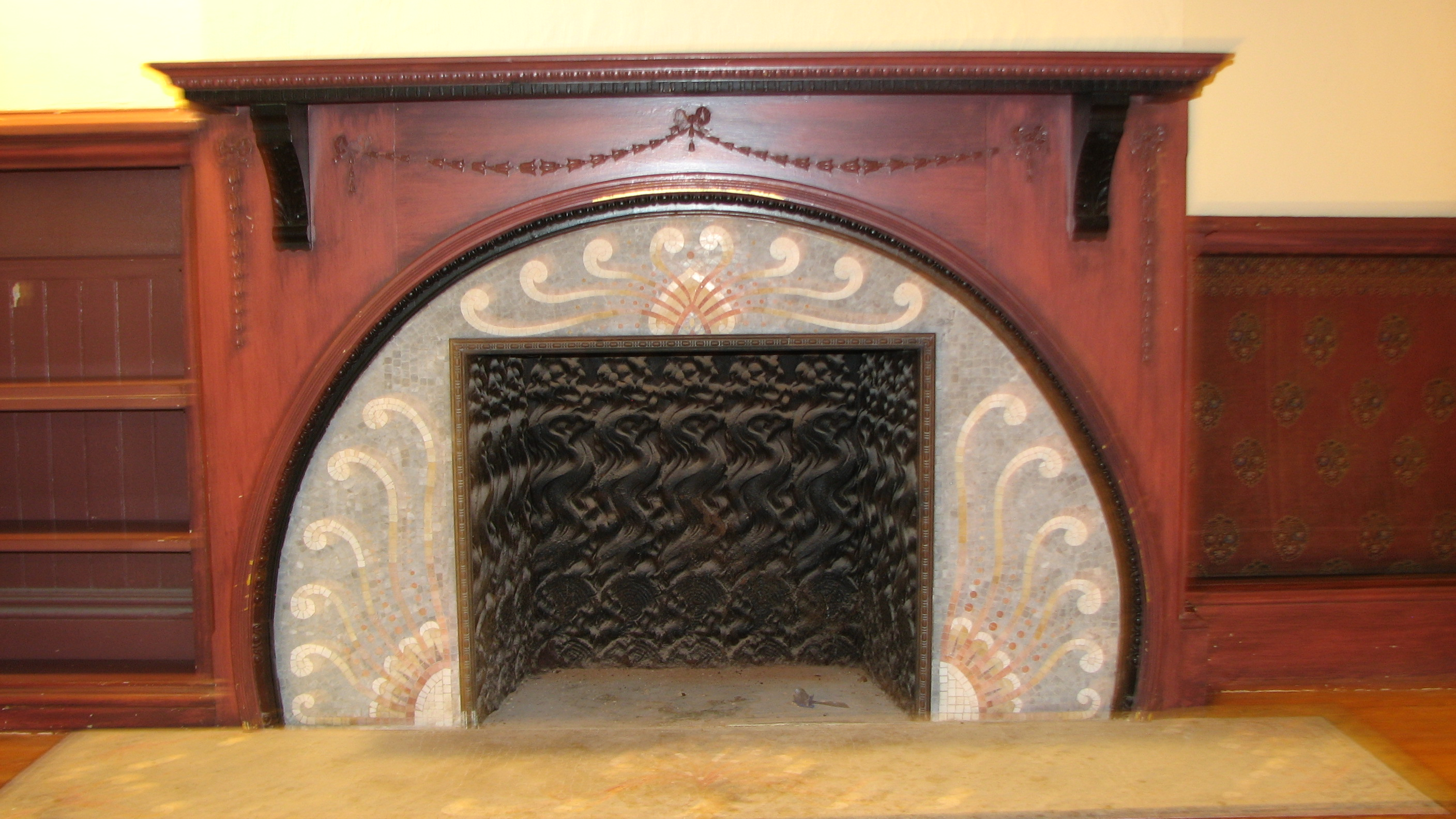 The house has unique fireplaces, including a beautiful mosaic hearth in the former ballroom.